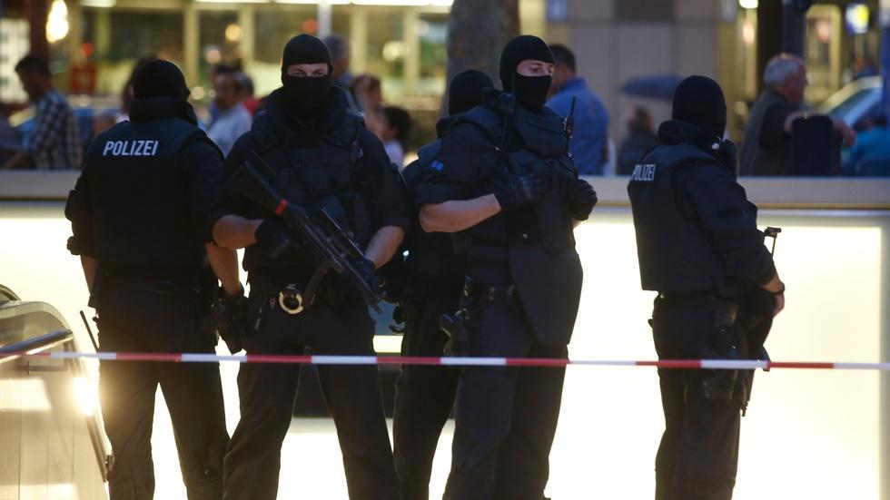 News Wrap: Deadly shooting rampage at German mall image
