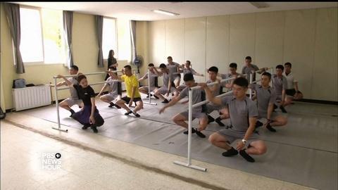 PBS NewsHour -- South Korean soldiers dance off stress