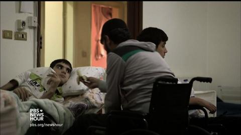 PBS NewsHour -- Victims of Syrian war find help in a home away from home