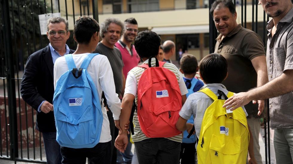 Greece sends stranded refugee children to school image