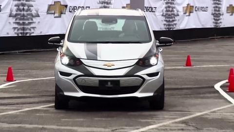 PBS NewsHour -- Companies race to make electric cars mainstream