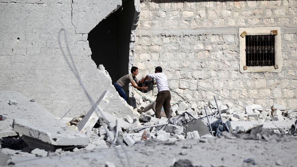 News Wrap: Russia and Syria halt Aleppo strikes temporarily image