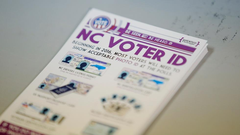 How are controversial voter ID laws affecting voters? image