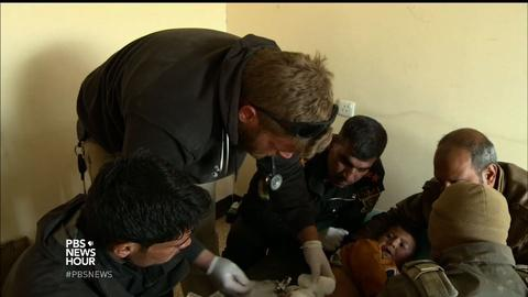 PBS NewsHour -- These volunteers risk their lives to save Mosul's injured