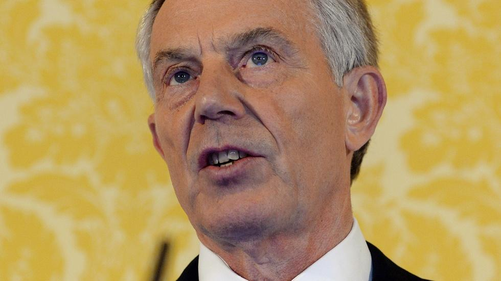 Tony Blair advocates for a new global policy 'center ground' image