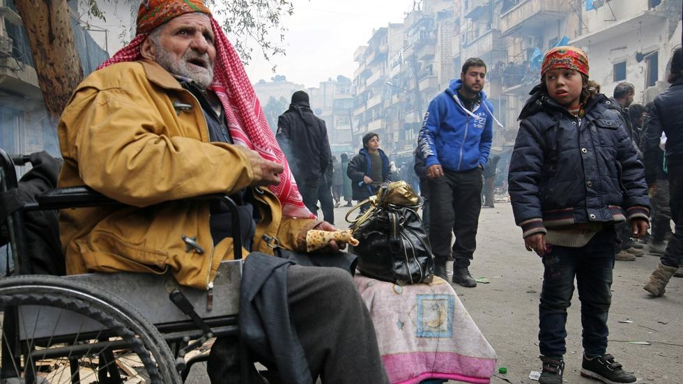 As Aleppo lies in ruins, thousands wait to escape image