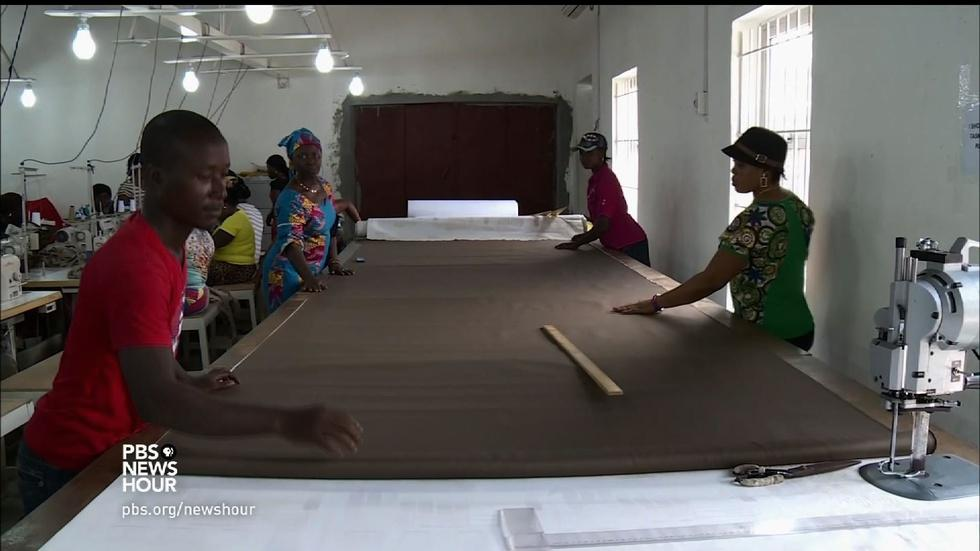 In Liberia, sewing school uniforms with social consciousness image