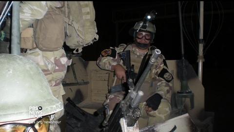 PBS NewsHour -- Immigration ban jeopardizes Iraqi translator's move to U.S.