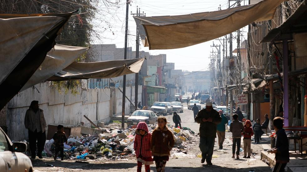 Areas of Mosul still under siege, but signs of life return image