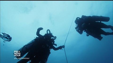 PBS NewsHour -- Is there hope for threatened coral reefs in the deep ocean?