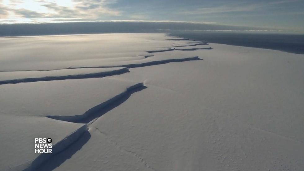 Massive ice shelf break forces researchers to evacuate image