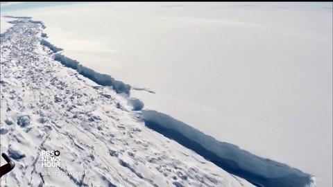 PBS NewsHour -- How scientists are tracking a massive iceberg in the making