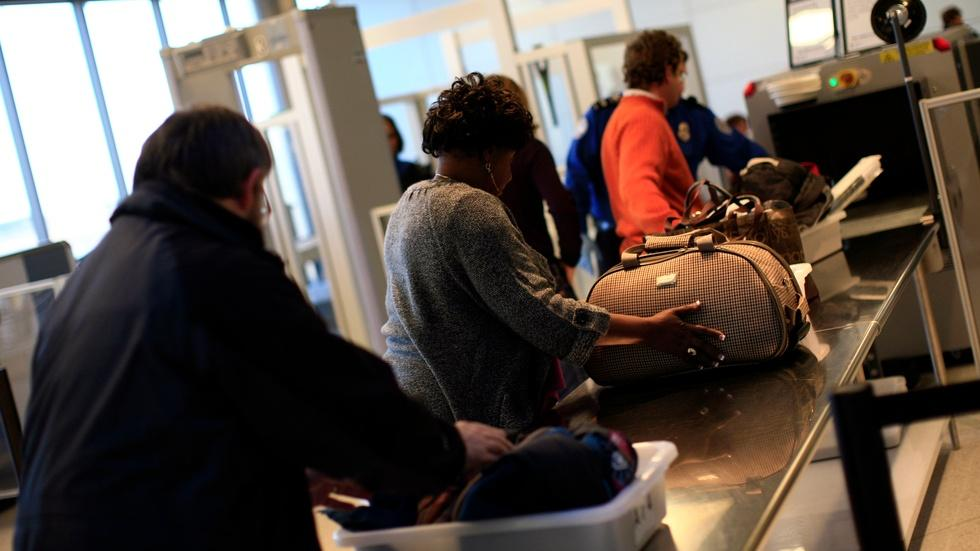 What sparked a new carry-on electronics ban on some flights? image