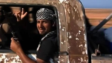 PBS NewsHour -- Gadhafi's Family Flees, but Hunt Remains for Libyan Leader
