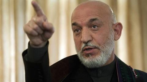 PBS NewsHour -- Afghanistan's Karzai to U.S. Troops: Leave Our Villages