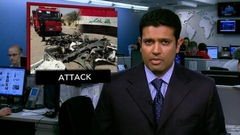 PBS NewsHour -- News Wrap: Iraqi Suicide Bombing Kills at Least 22,...