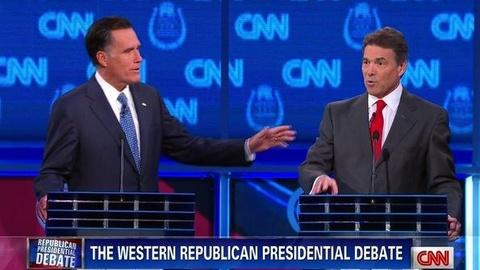 PBS NewsHour -- Heavyweights Romney, Perry Spar in Latest Debate; 9-9-9...