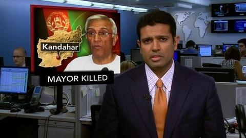PBS NewsHour -- News Wrap: Kandahar Mayor Assassinated in Suicide Bombing