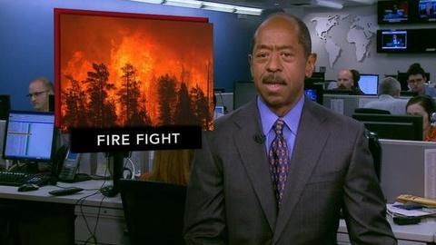 PBS NewsHour -- News Wrap: Ariz. Firefighters Ramp Up Battle Against...