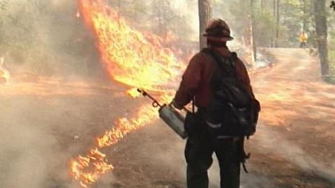 PBS NewsHour -- Witness: Texas Wildfire 'Just Like Driving Into a Volcano'