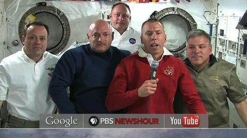 PBS NewsHour -- Mark Kelly Followed Wife Giffords' Latest Surgery From Space