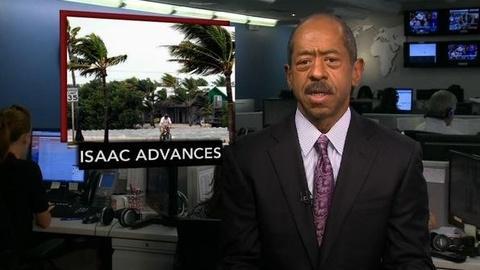 PBS NewsHour -- News Wrap: Nearing Louisiana, Isaac Reaches Hurricane Status