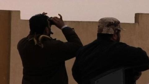 PBS NewsHour -- Gadhafi's Troops Advance on Rebel-Held Cities as U.N. OKs...