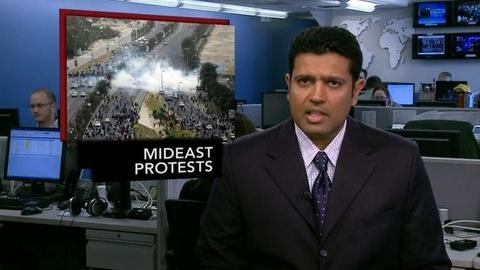 PBS NewsHour -- News Wrap: Police in Yemen Raid Protesters' Camps,...