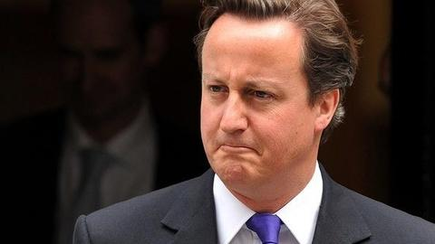 PBS NewsHour -- Cameron 'Weakened' by Scandal, But Appears to Be Out of...