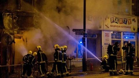 PBS NewsHour -- What's Fueling the Rioting Raging Across United Kingdom?