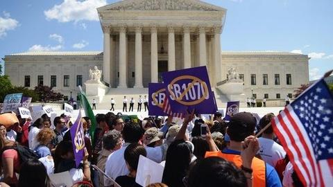PBS NewsHour -- Supreme Court Upholds Controversial Part of Immigration Law