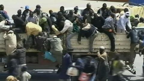 PBS NewsHour -- In Misrata Port, Ship Braves Shelling to Save Patients,...