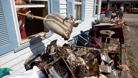 PBS NewsHour -- Flood Waters Still Wreak Havoc in Northeast as Costs Mount