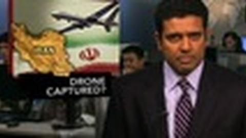 PBS NewsHour -- News Wrap: U.S. Denies Iranian Claim of Seizing Drone