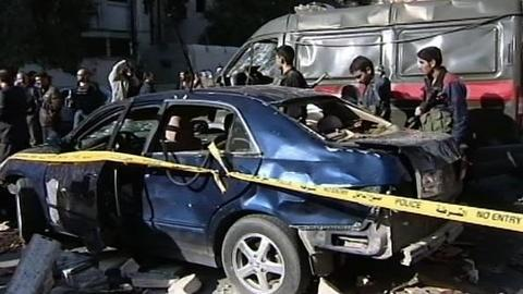 PBS NewsHour -- Syria's Claims Over 'Unusual' Bombings in Damascus Draw...