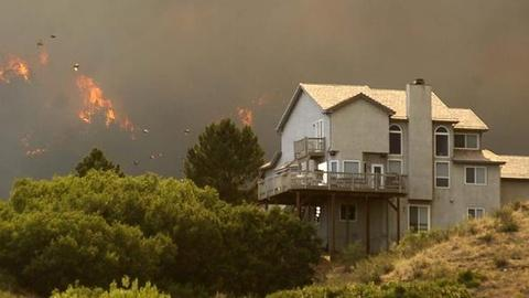 PBS NewsHour -- Thousands Flee After Colorado Fire Doubles in Size