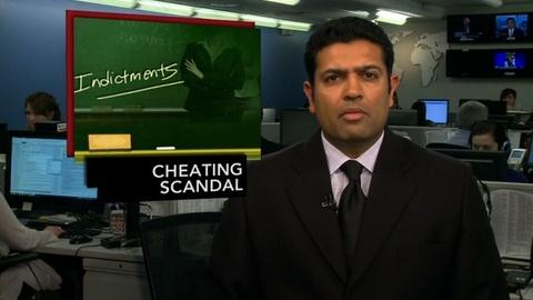 PBS NewsHour -- News Wrap: Atlanta Educators Indicted for Cheating