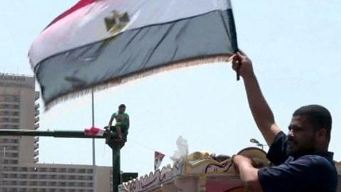 PBS NewsHour -- Pro- and Anti-Morsi Demonstrators Clash Across Egypt