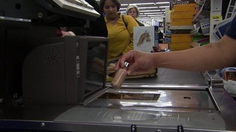 PBS NewsHour -- D.C. Wages Fight With Walmart Over Higher Wages