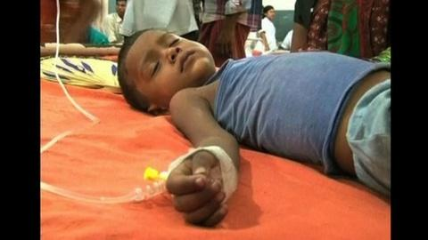 PBS NewsHour -- More Than 20 Indian Students Die After Eating School Lunches