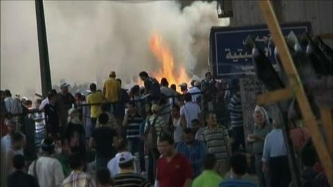PBS NewsHour -- Bloodshed, Death Toll Mount as 'Day of Rage' Across Egypt
