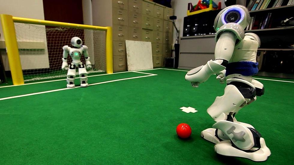 Soccer Playing Robots image