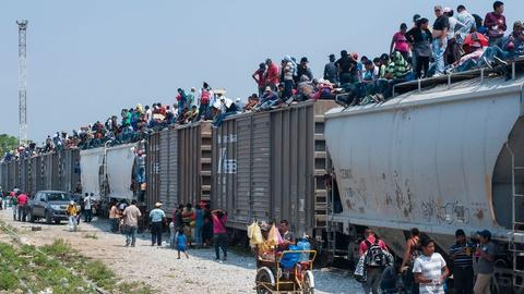 Migrant Crisis; Latino Converts to Islam; Carrie Newcomer