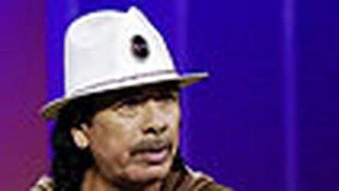 Tavis Smiley -- Carlos Santana (r): Wednesday, 7/22