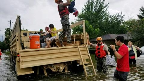 PBS NewsHour -- Torrential rains drain emergency resources in Texas