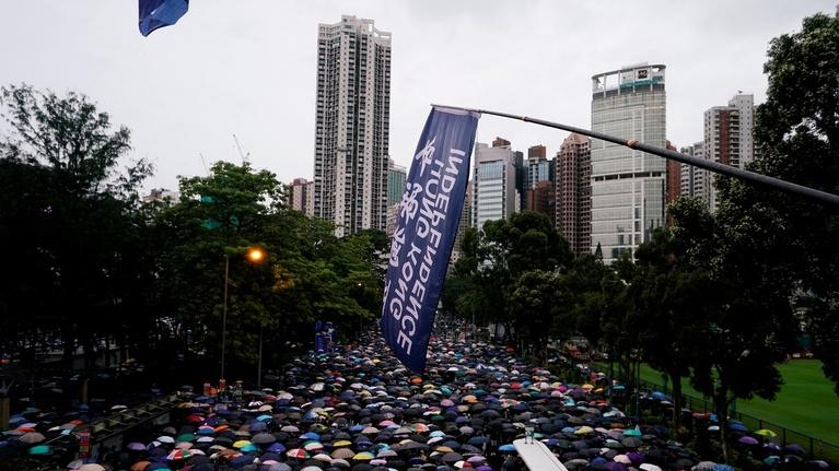 PBS NewsHour: After recent chaos, Hong Kong protesters hold peaceful march