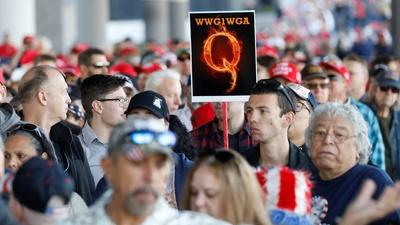 PBS NewsHour   How QAnon conspiracy theory gained 2020 campaign traction