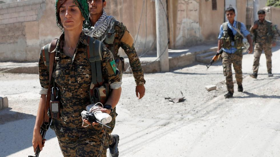 Fighting ISIS, Kurds seek chance to govern themselves image
