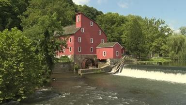 What makes the Red Mill Museum Village a fan favorite?