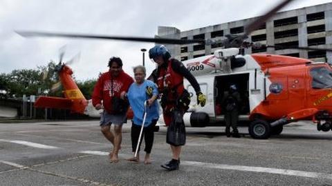 PBS NewsHour -- Hurricane rescue crews face 'more calls than capacity'